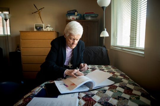 """Sr. Rose Ann Fleming sits on her bed and prepares a brief for a social security hearing that she is working on as part of The Volunteer Lawyers Project Saturday, February 16, 2019 in her apartment on Xavier University's campus. Fleming talks about not giving up on people and says, """"We all make mistakes."""" Fleming draws inspiration from Robert K. Greenleaf, author of the book """"Servant Leadership,"""" to define success. ÒDid I help anyone today? If you did, you were successful. I have always been inspired by that definition,"""" she says."""