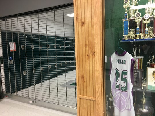 A jersey and trophies in a display case line a hallway inside the 211-student Silver Grove Independent School District that is seeking to merge with Campbell County Schools.