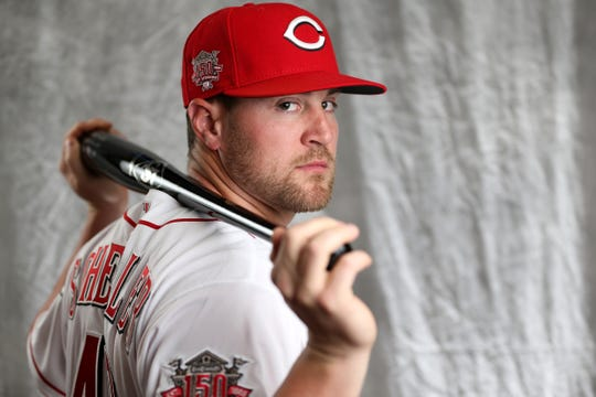 Cincinnati Reds right fielder Scott Schebler (43) poses for a portrait on picture day, Tuesday, Feb. 19, 2019, at the Cincinnati Reds spring training facility in Goodyear, Arizona.