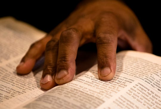 Moreh Yashashakar reads from his bible   and says it provides evidence the he and other members of the Nation of Israel are among the biblical Twelve Tribes of Israel.
