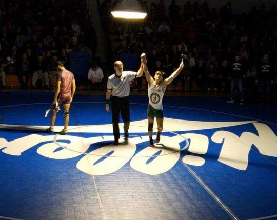 St. Joseph wrestler Derek Zelesnick won the District 14 title at 138 pounds.