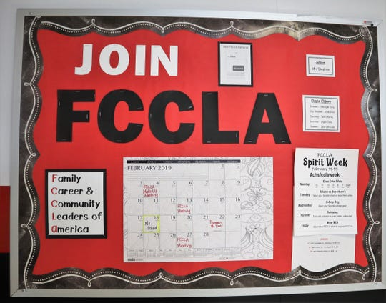A decorated board in Coshocton High School supports and promotes the local Family Career and Community Leaders of America Club.