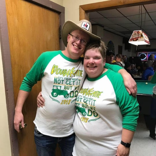 Doug and Katie Vaske wear the T-shirts they made that celebrate Farmers Only.