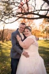 Doug and Katie Vaske pose at their wedding