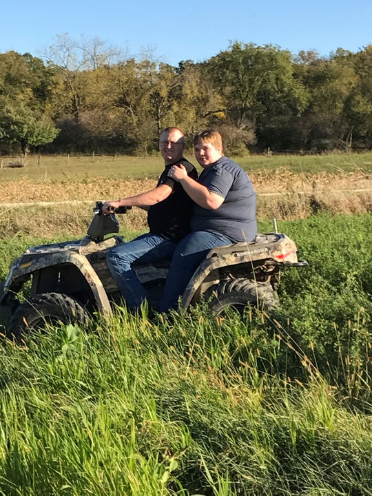 Doug and Katie Vaske go four wheeling in one of their engagement pictures