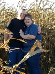Doug and Katie Vaske pose in their corn