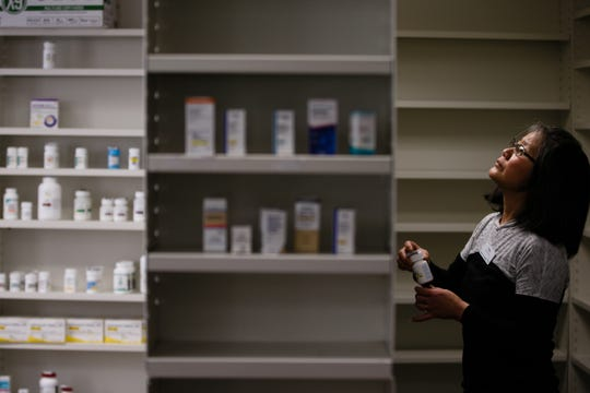 Raja Seda of Greenfield continues to sort and organize NuCara's medications on Tuesday, Feb. 19, 2019 in Greenfield. The towns only pharmacy closed when Shopko closed its doors and transferred all it's clients to Walgreens in Clive. Pharmacist Rachel Hall partnered with NuCara, a small chain of pharmacies, and together they managed to open a pharmacy the day after Shopko closed.