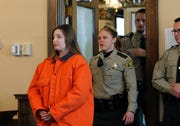 Cheyanne Renae Harris, left, enters the courtroom prior to sentencing Tuesday, Feb. 19, 2019, in New Hampton, Iowa.