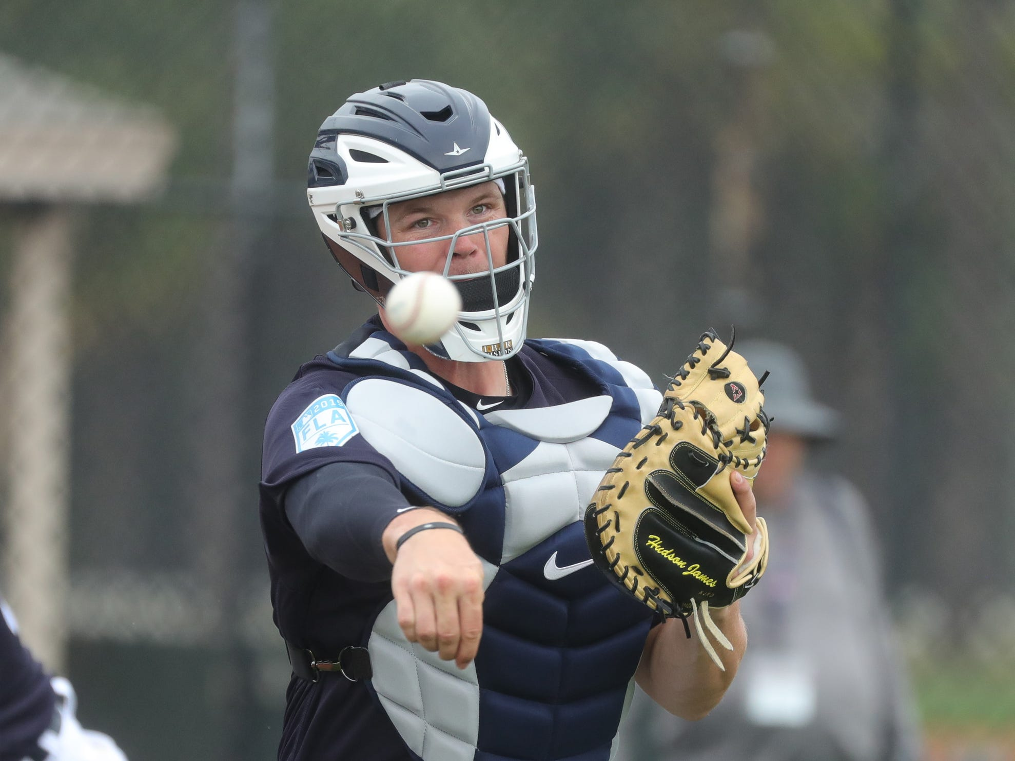 Detroit Tigers catcher Grayson Greiner throws to first base during practice Monday, Feb. 18, 2019 at Publix Field at Joker Marchant Stadium in Lakeland, Fla.