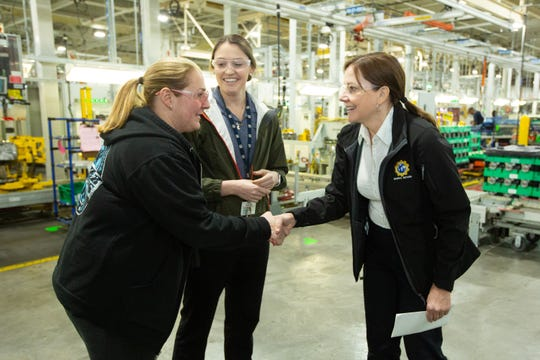 General Motors Chairman and CEO Mary Barra, right, talks with employees Angela Jarrett, left, and Kayla Owens on Tuesday, Feb. 19, 2019, at the GM Romulus Propulsion plant in Romulus.