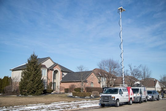 TV trucks are seen outside of Taylor mayor Rick Sollars' house on Hunter Circle in Taylor on Tuesday, Feb. 19, 2019.