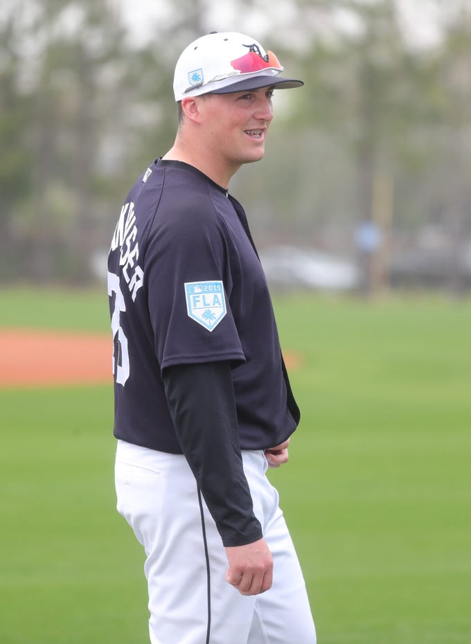 Tigers pitcher Kyle Funkhouser talks with teammates during spring training on Monday, Feb. 18, 2019, in Lakeland, Florida.