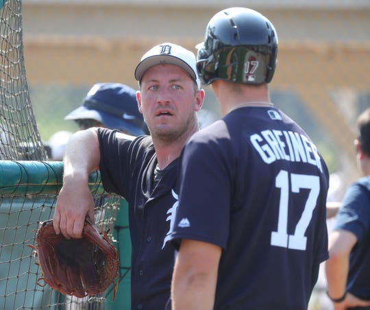 Tigers pitcher Jordan Zimmermann talks with catcher Grayson Greiner during batting practice during spring training on Tuesday, Feb. 19, 2019, at Joker Marchant Stadium in Lakeland, Florida.