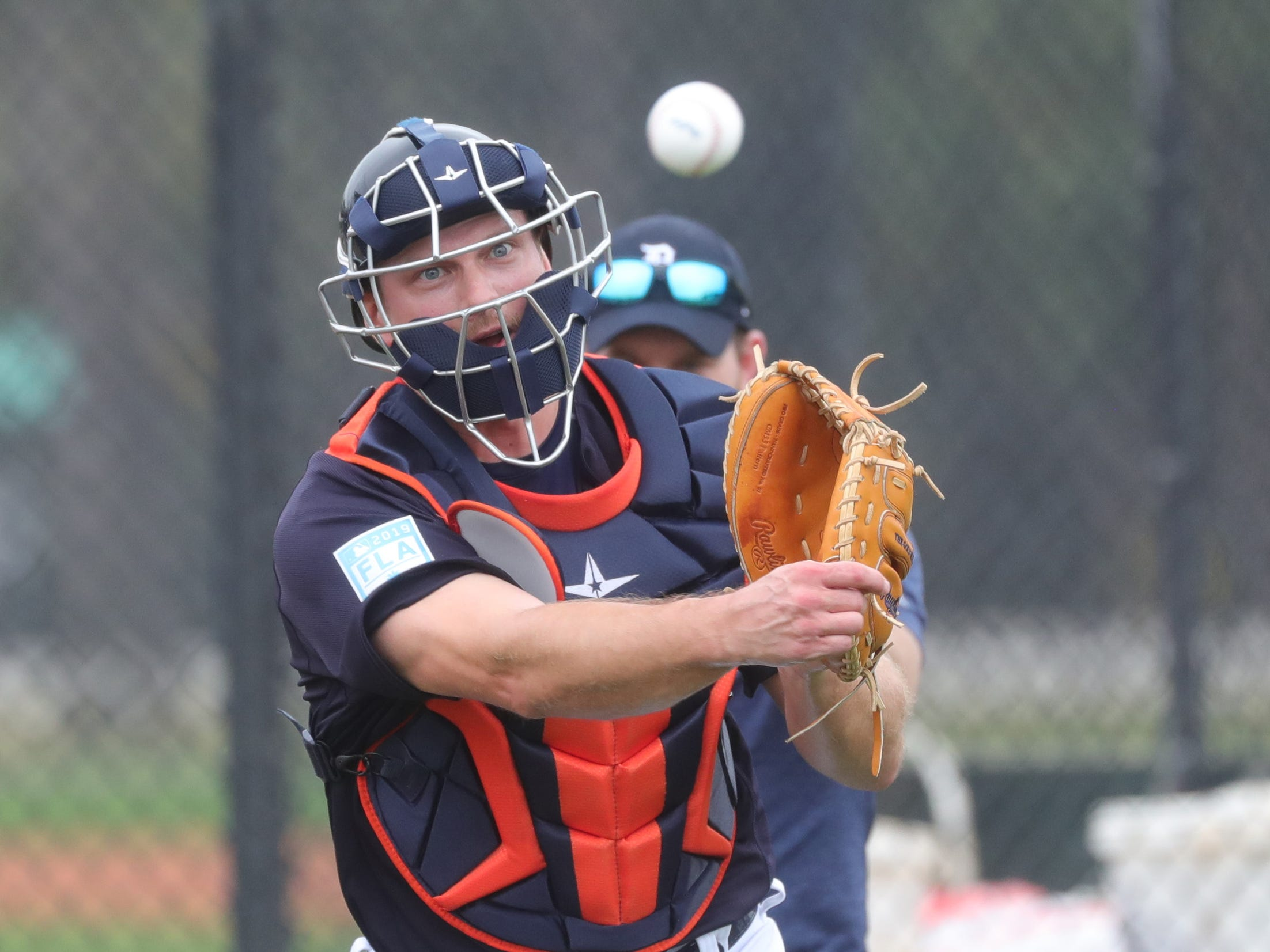 Detroit Tigers catcher John Hicks throws to first base during practice Monday, Feb. 18, 2019 at Publix Field at Joker Marchant Stadium in Lakeland, Florida.