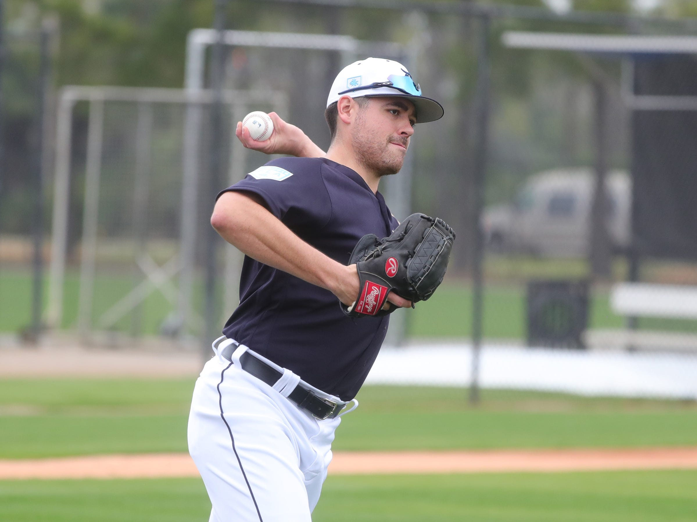 Detroit Tigers pitcher Matt Moore throws to first base during practice Monday, Feb. 18, 2019 at Publix Field at Joker Marchant Stadium in Lakeland, Fla.