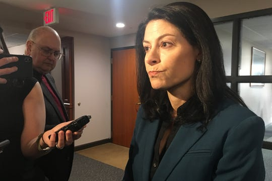 State Attorney General Dana Nessel answers questions in a media scrum after testifying before the state House Judiciary committee on Tuesday, February 19, 2019.
