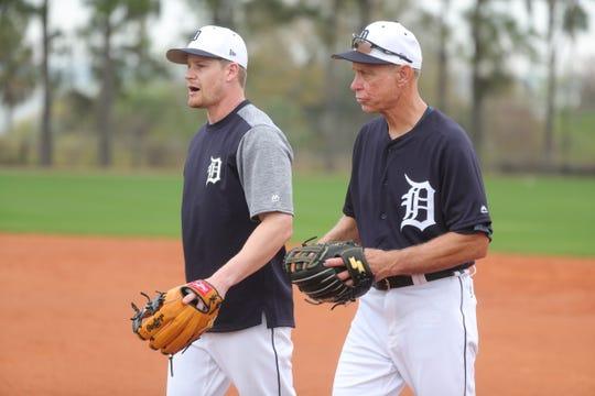 Detroit Tigers infielder Gordon Beckham, left, talks with Hall of Famer Alan Trammell during practice Monday, Feb. 18, 2019 at Publix Field at Joker Marchant Stadium in Lakeland, Fla.