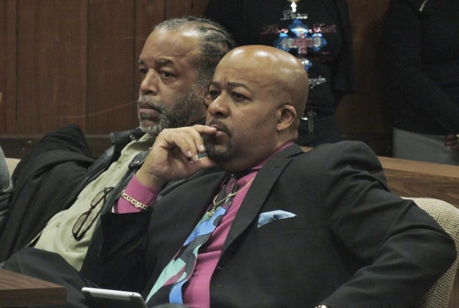Attorney Clifford Woodards, right, is seen in court in 2015.