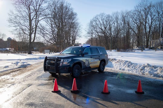 Kent County Sheriff personnel investigate the scene of a fatal shooting near the corner of 19 Mile NE and Division Avenue NE at a property on Monday, Feb. 18, 2019, near Cedar Springs, Mich.