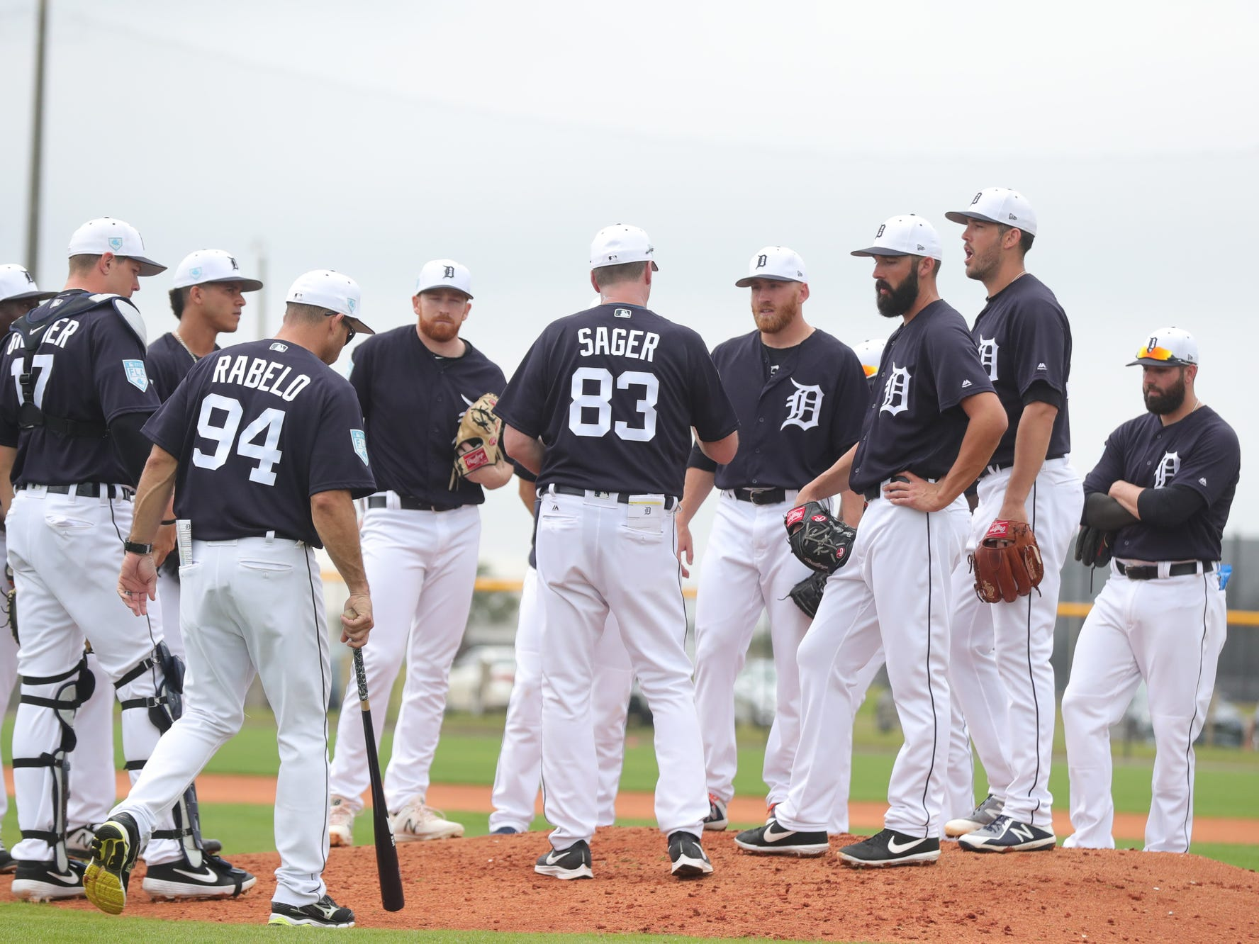 Detroit Tigers pitchers listen to instructions from coach A. J. Sager during practice Monday, Feb. 18, 2019 at Joker Marchant Stadium in Lakeland, Fla.