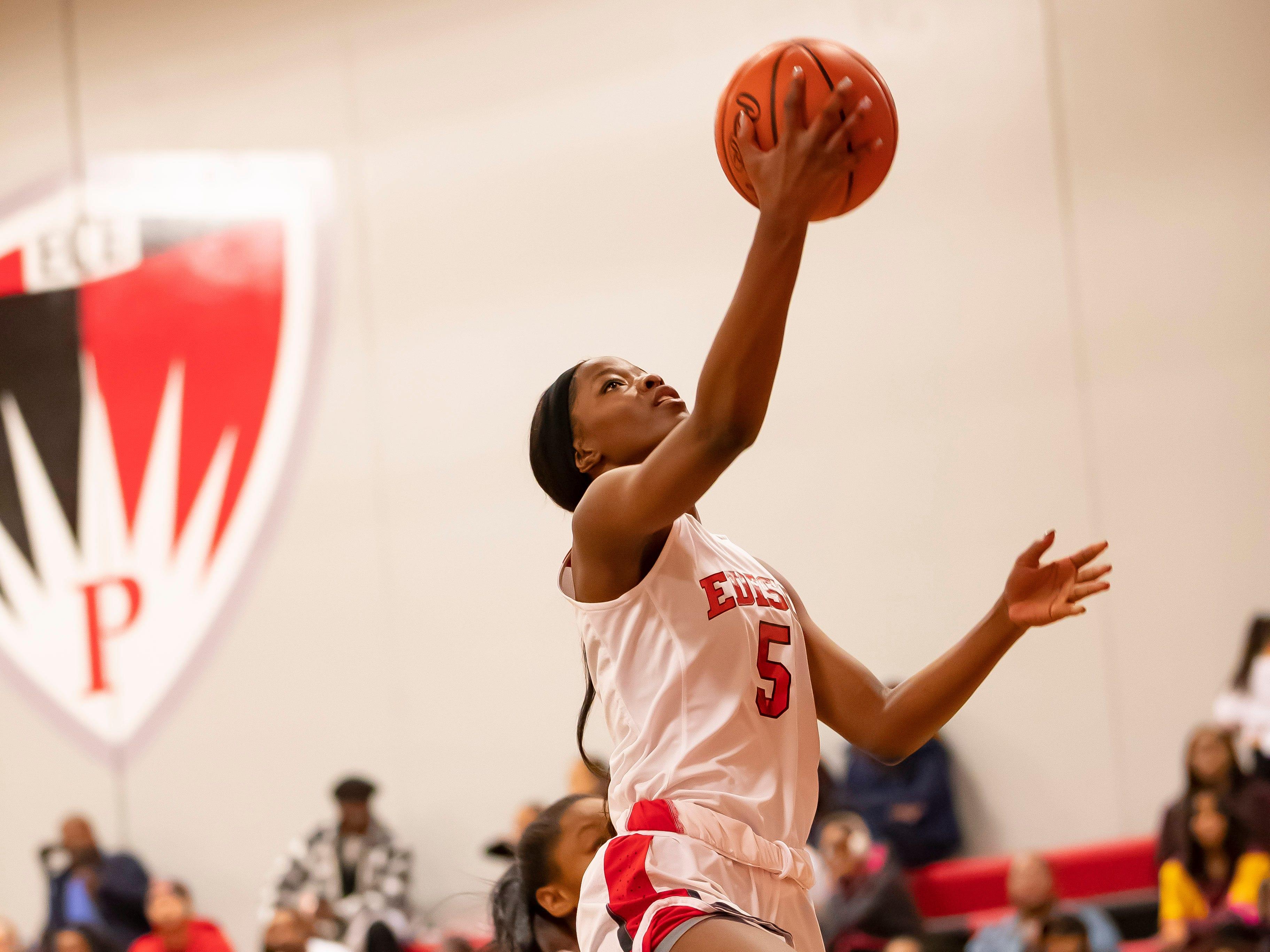Rickea Jackson of Edison Academy drives to the basket against Detroit Renaissance.