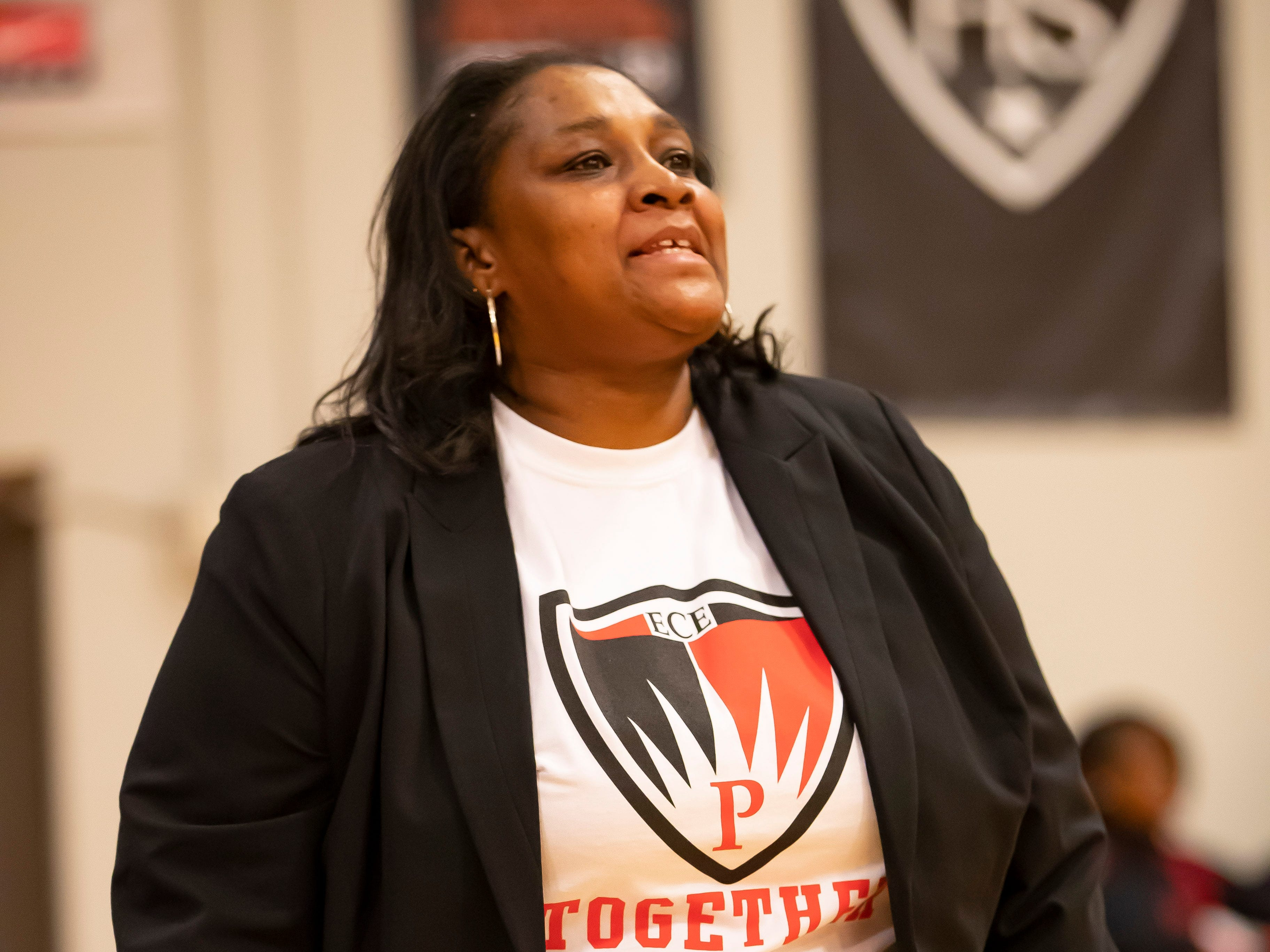 Head coach Monique Brown of Edison Academy watches the play from the sidelines.