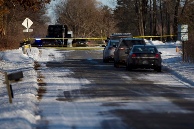 Kent County Sheriff personnel investigate the scene of a fatal shooting on Monday, Feb. 18, 2019, near Cedar Springs, Michigan.