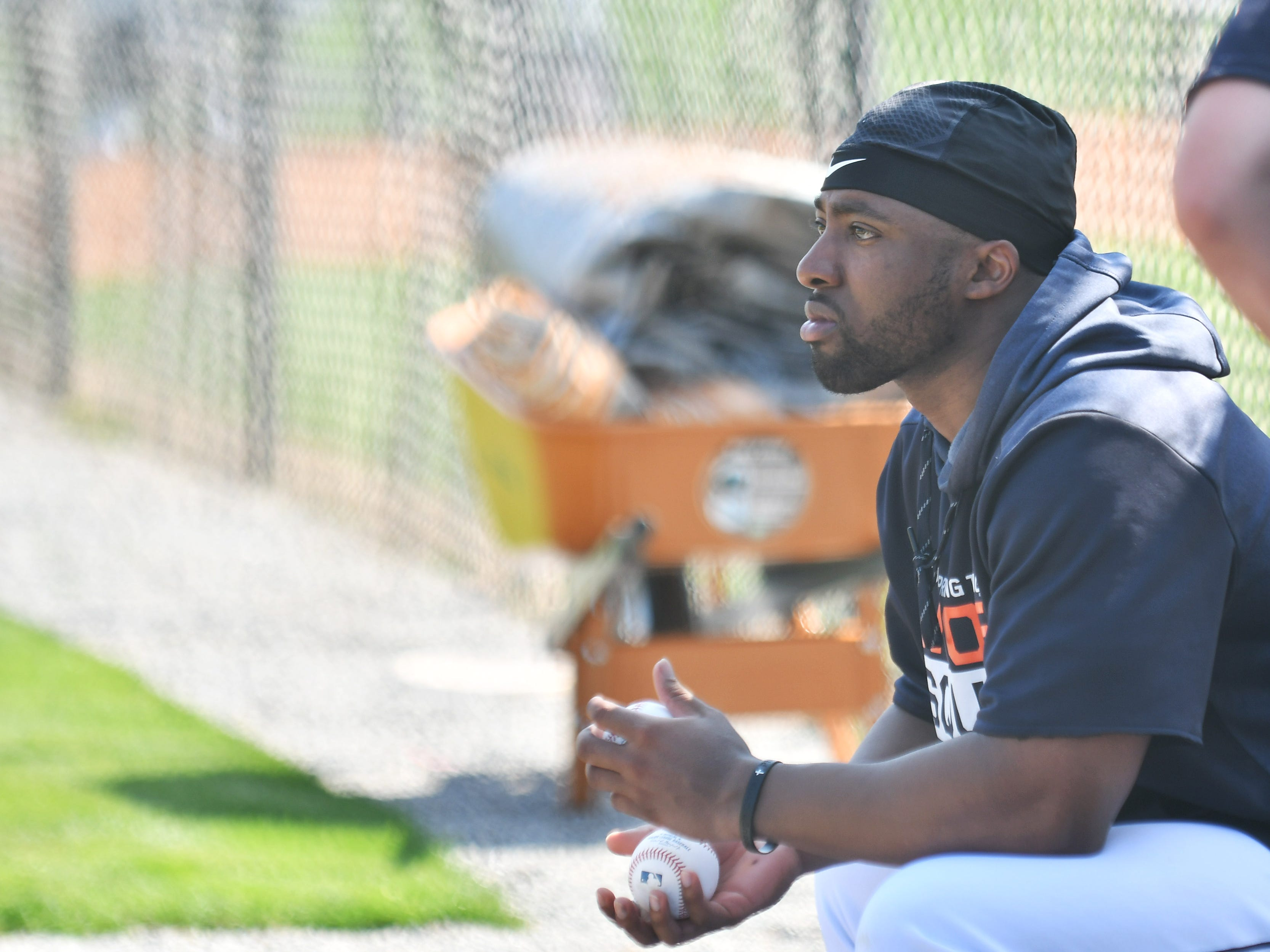 A penny for the thoughts of Tigers' Christin Stewart as he watches live batting practice.
