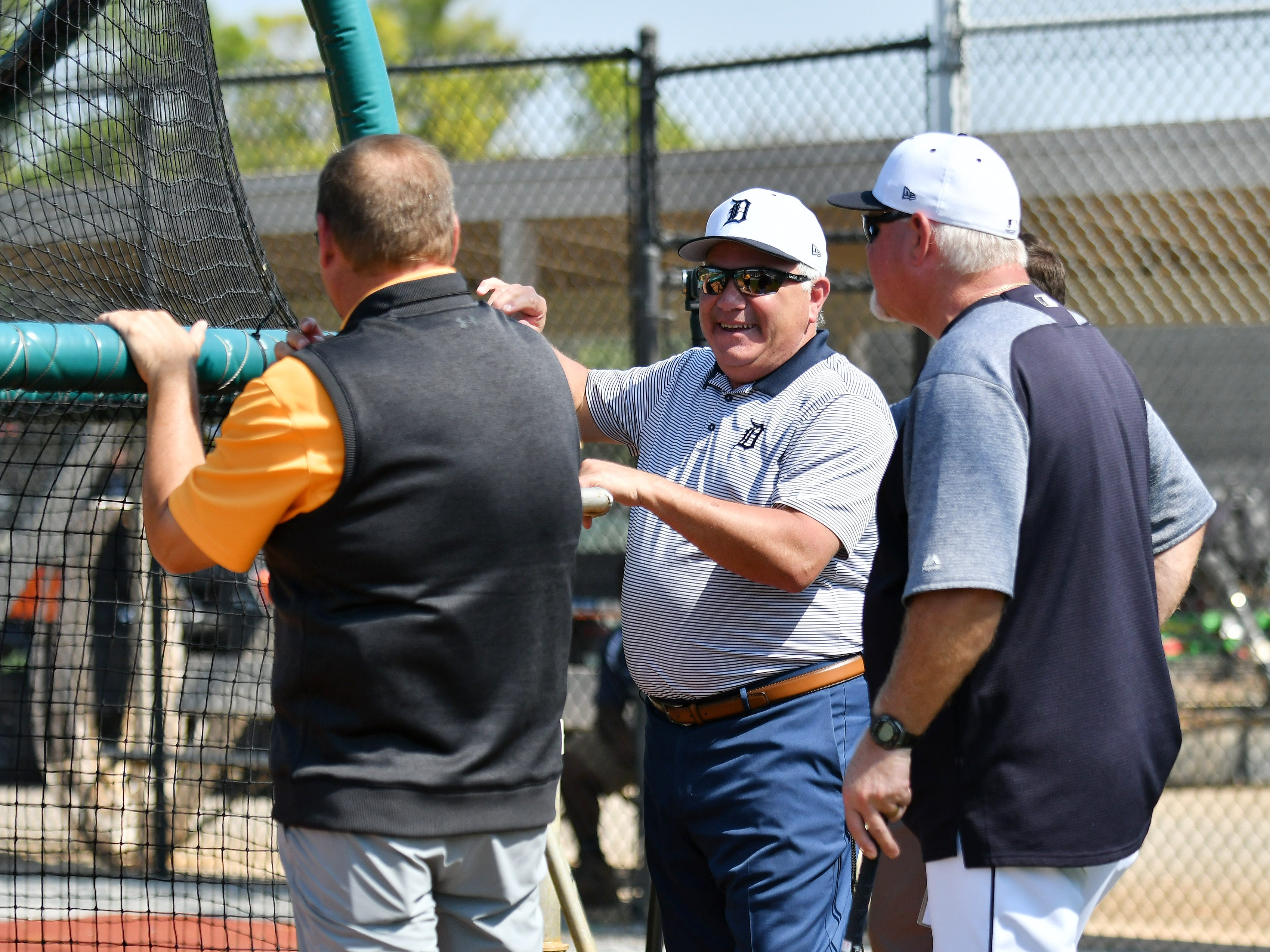 Tigers executive vice president of baseball operations and general manager, center, talks with manager Ron Gardenhire, right, and vice president, assistant general manager David Chadd talk during batting practice.