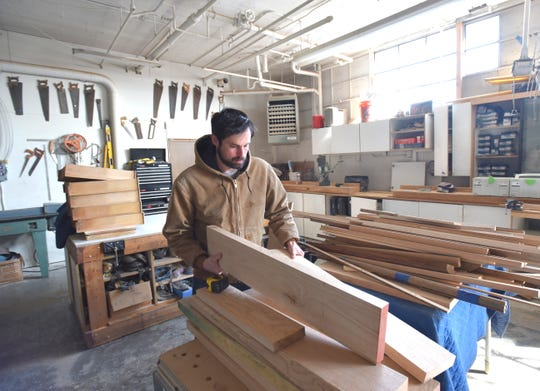 Ponyride co-founder Phil Cooley prepares to measure some lumber to build a table for a customer in the  Ponyride wood shop. After selling the Corktown building that houses the business incubator for $3.3 million, Ponyride will soon move to 5203 Loraine St. near Grand River in the Core City neighborhood.