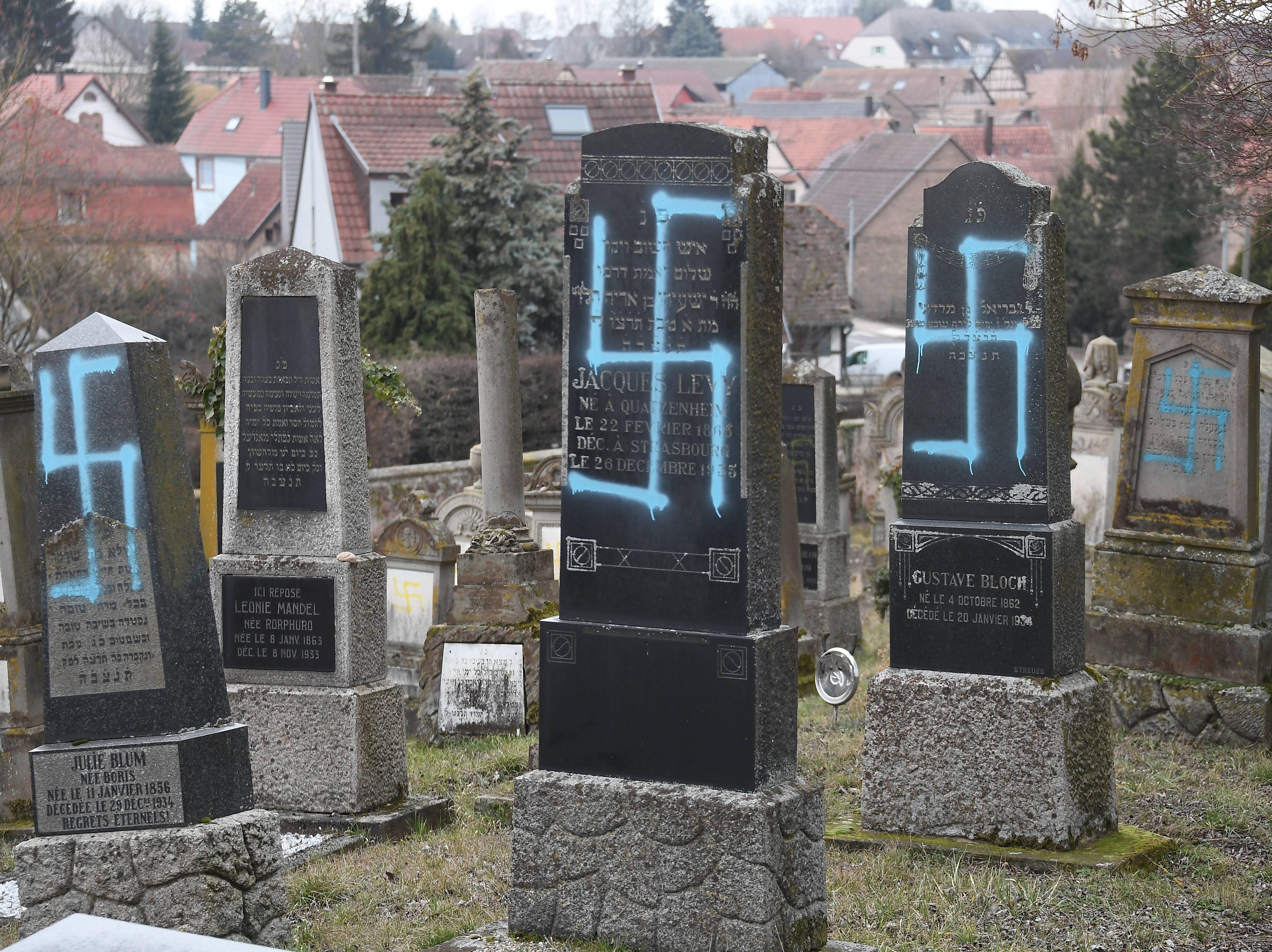 A picture taken on February 19, 2019 in Quatzenheim shows svastikas painted on graves at a Jewish cemetery, on the day of a nationwide marches against a rise in anti-Semitic attacks. - Around 80 graves have been vandalised. The damage was discovered on Tuesday morning at a cemetery in the village of Quatzenheim, close to the border with Germany in the Alsace region, a statement from the regional security office said.