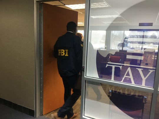 An FBI agent enters the Department of Development office at Taylor City Hall on Tuesday, Feb. 19, 2019.