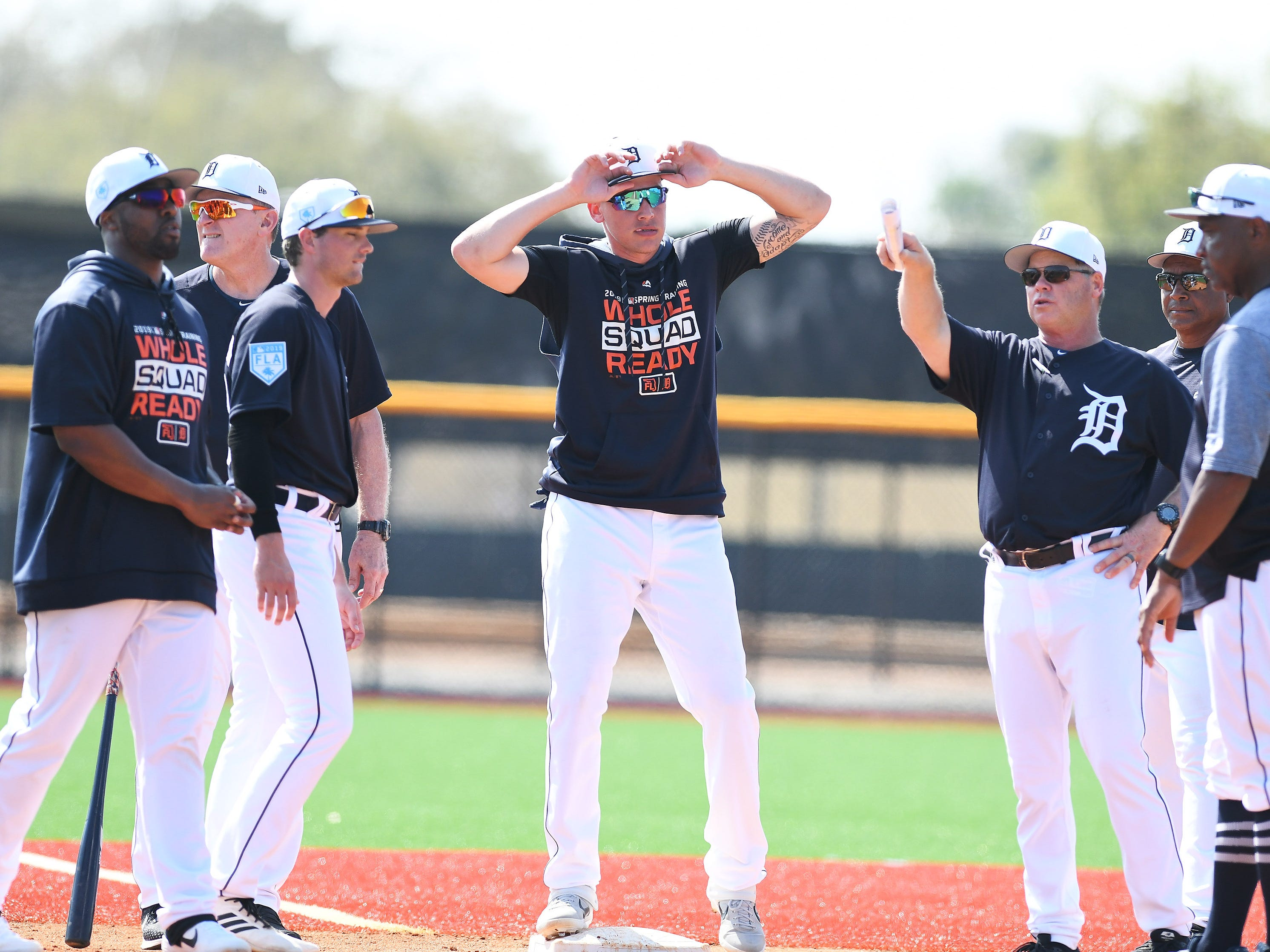 Tigers' JaCoby Jones, center, listens to instructions from quality control coach Joe Vavra, right, during base running drills.