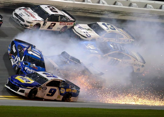 Chase Elliott (9), Ricky Stenhouse Jr. (17), Brad Keselowski (2), Kyle Larson (42), Ty Dillon (13) and Alex Bowman (88) wreck in Turn 3 during the NASCAR Daytona 500 Sunday at Daytona International Speedway.