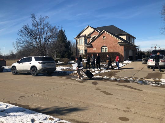 FBI agents were spotted leaving Mayor Rick Sollars' home after 2 p.m. carrying boxes and folders and a backpack.