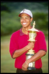 Tiger Woods, here proudly hugging the 1995 U.S. Amateur Championship trophy, met Hootie and the Blowfish's Darius Rucker at Rick's American Cafe in East Lansing that same year, the lead singer recalls.