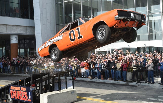"Rayond Kohn of the Northeast Ohio Dukes drives a General Lee replica form the ""Dukes of Hazzard"" television show to open the 2017 Autorama behind Cobo Center."