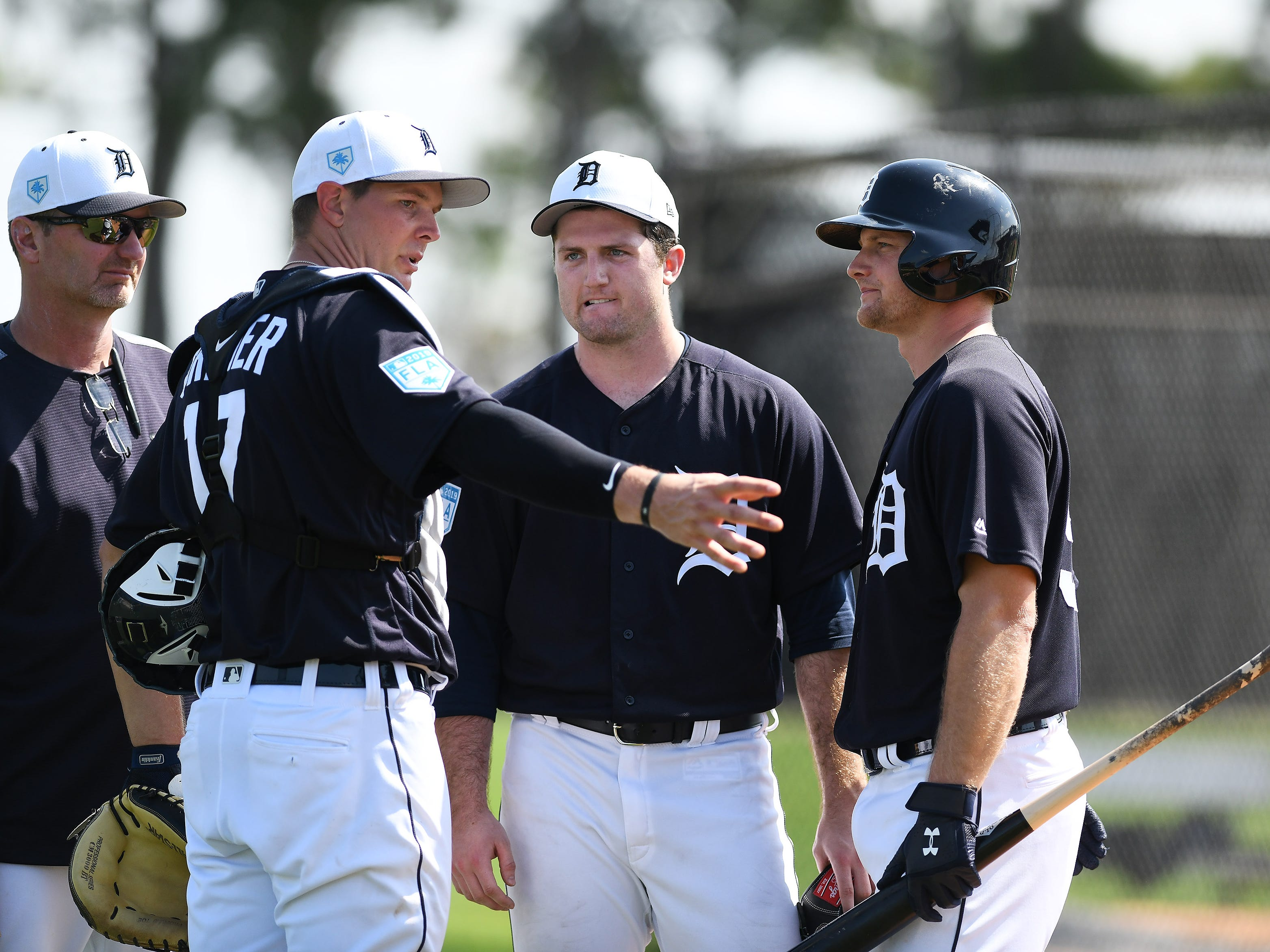 Tigers catcher Grayson Greiner (17) talks with pitcher Casey Mize and catcher John Hicks, right, after Mize pitched live batting practice.