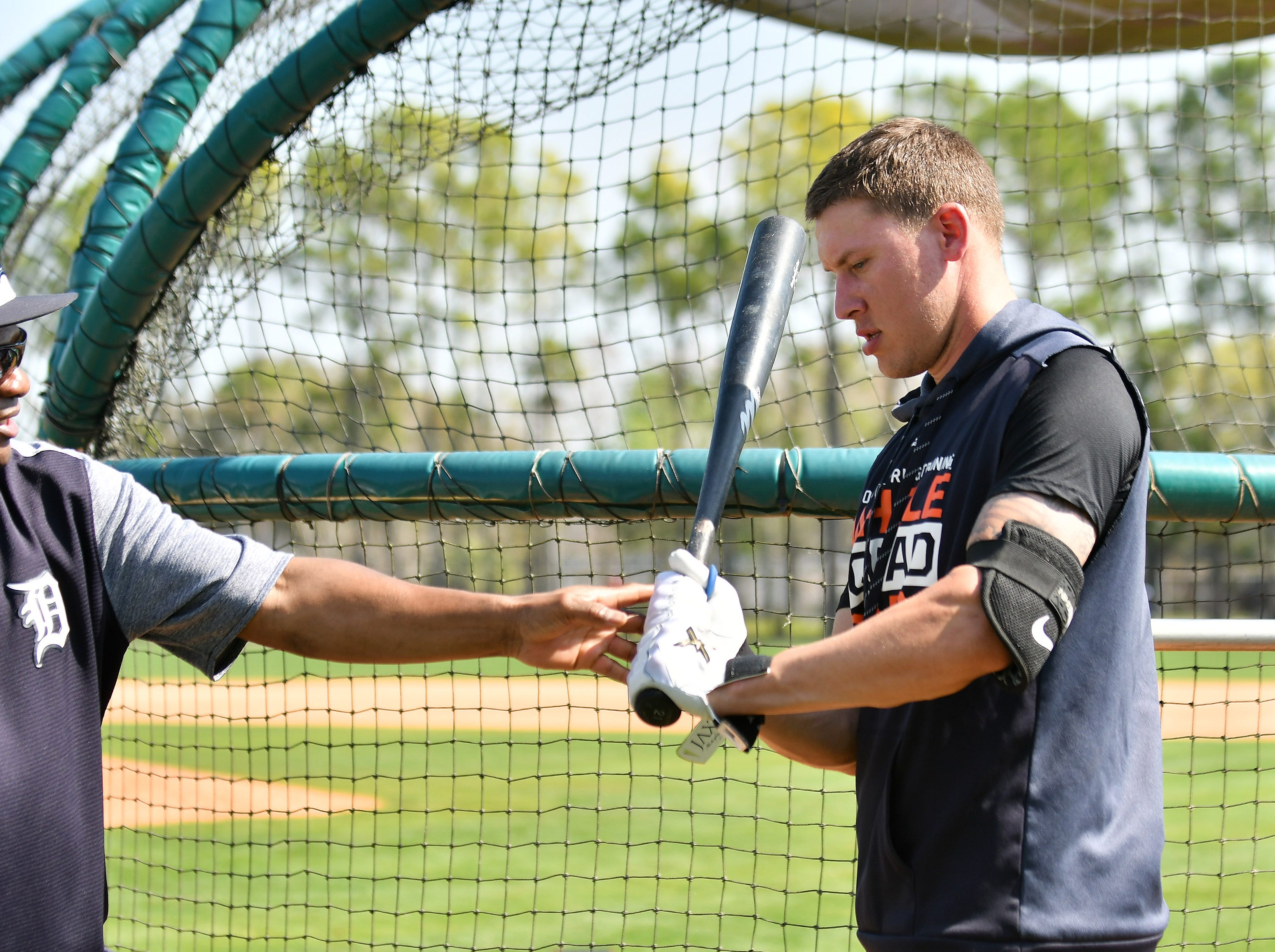 Tigers hitting coach Lloyd McClendon, left, works with JaCoby Jones during batting practice.