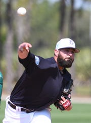 Tigers pitcher Kaleb Cowart throws live batting practice during the Tigers' workout Tuesday at spring training in Lakeland, Fla.