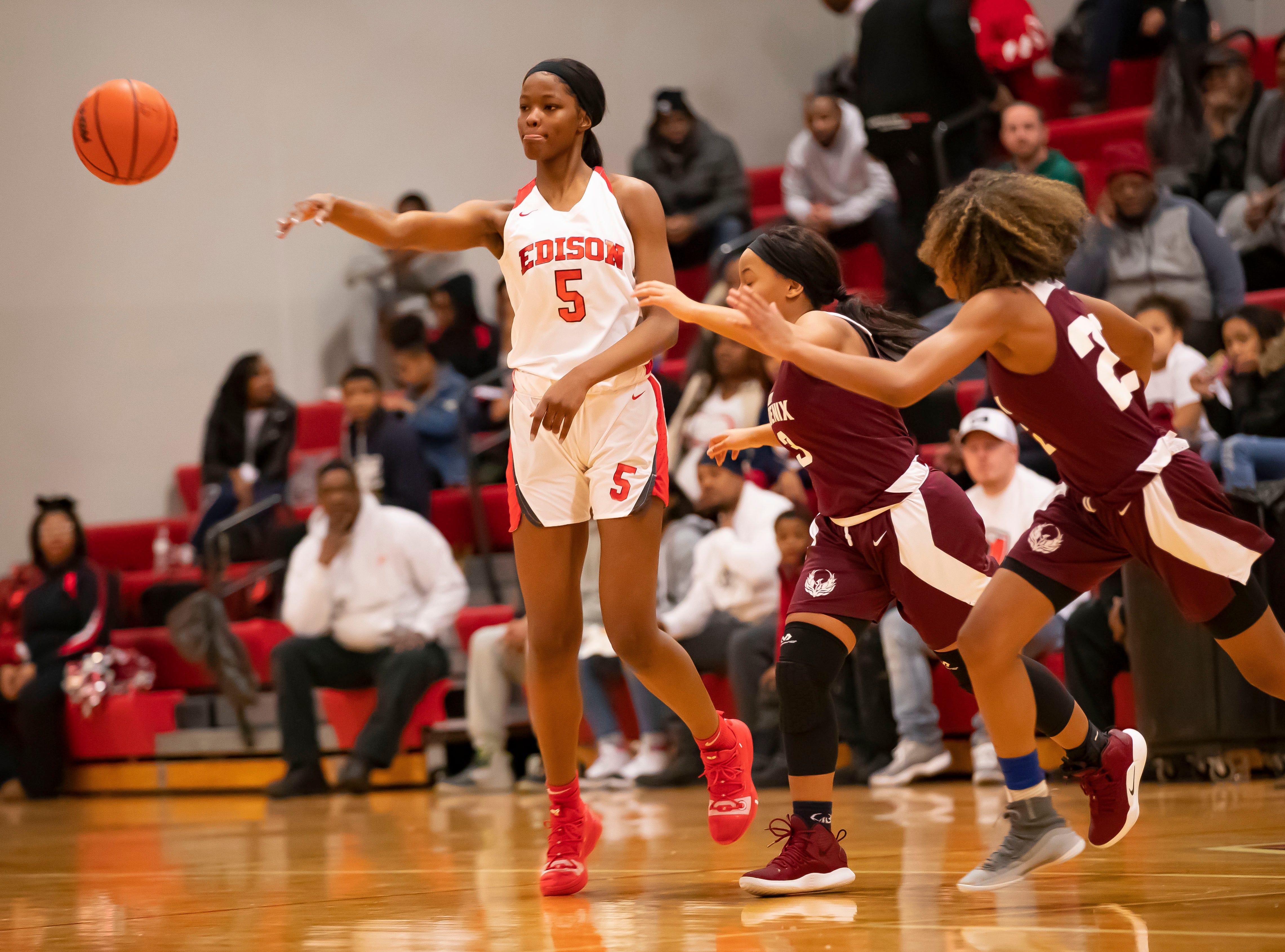 Rickea Jackson of Edison Academy passes the ball away from Detroit Renaissance.