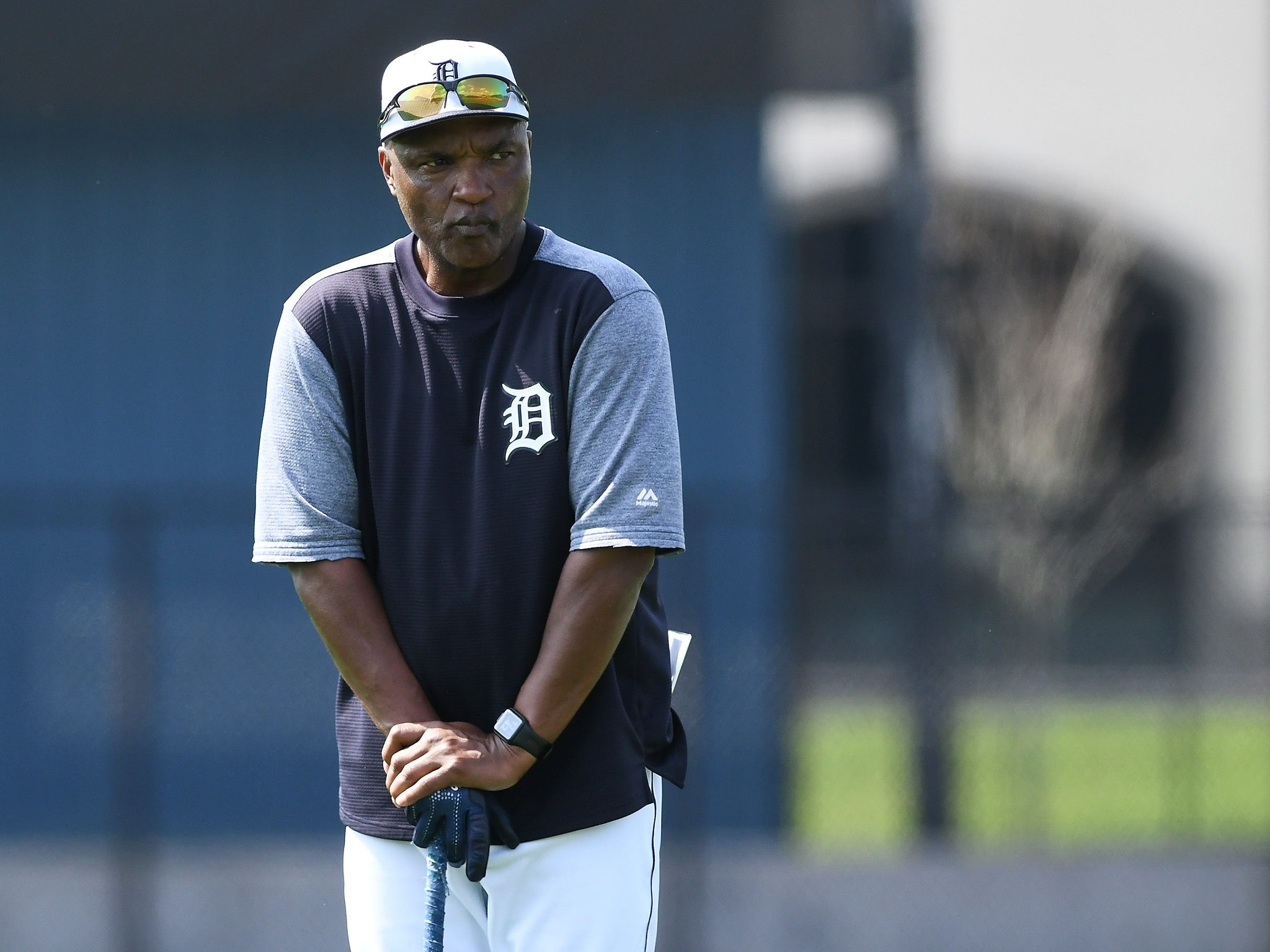 Tigers third base coach Dave Clark oversees sprints by outfielders.