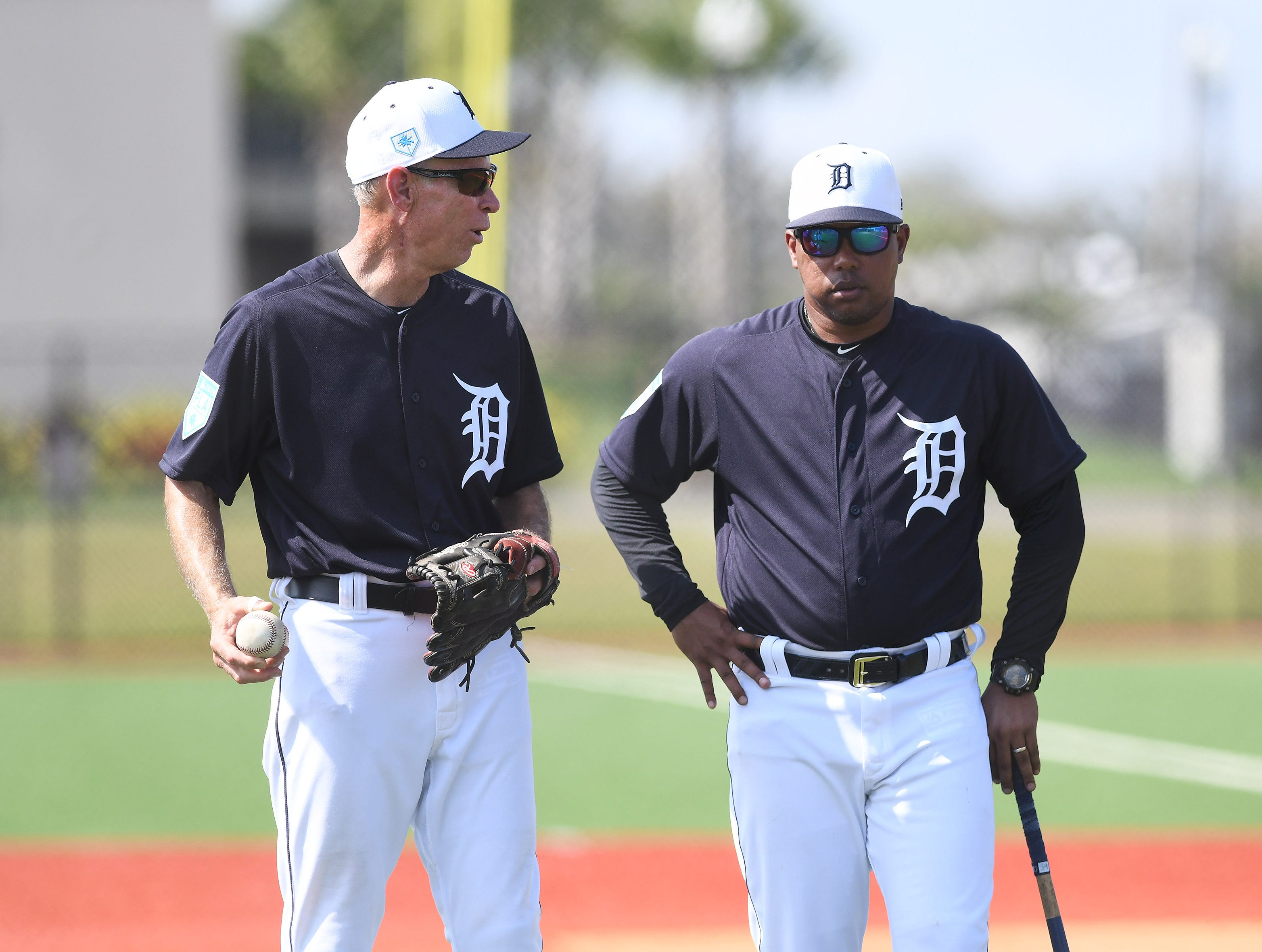 Tigers special assistant to the general manager Alan Trammell, left, talks with first base coach Ramon Santiago at the Tigers workout.