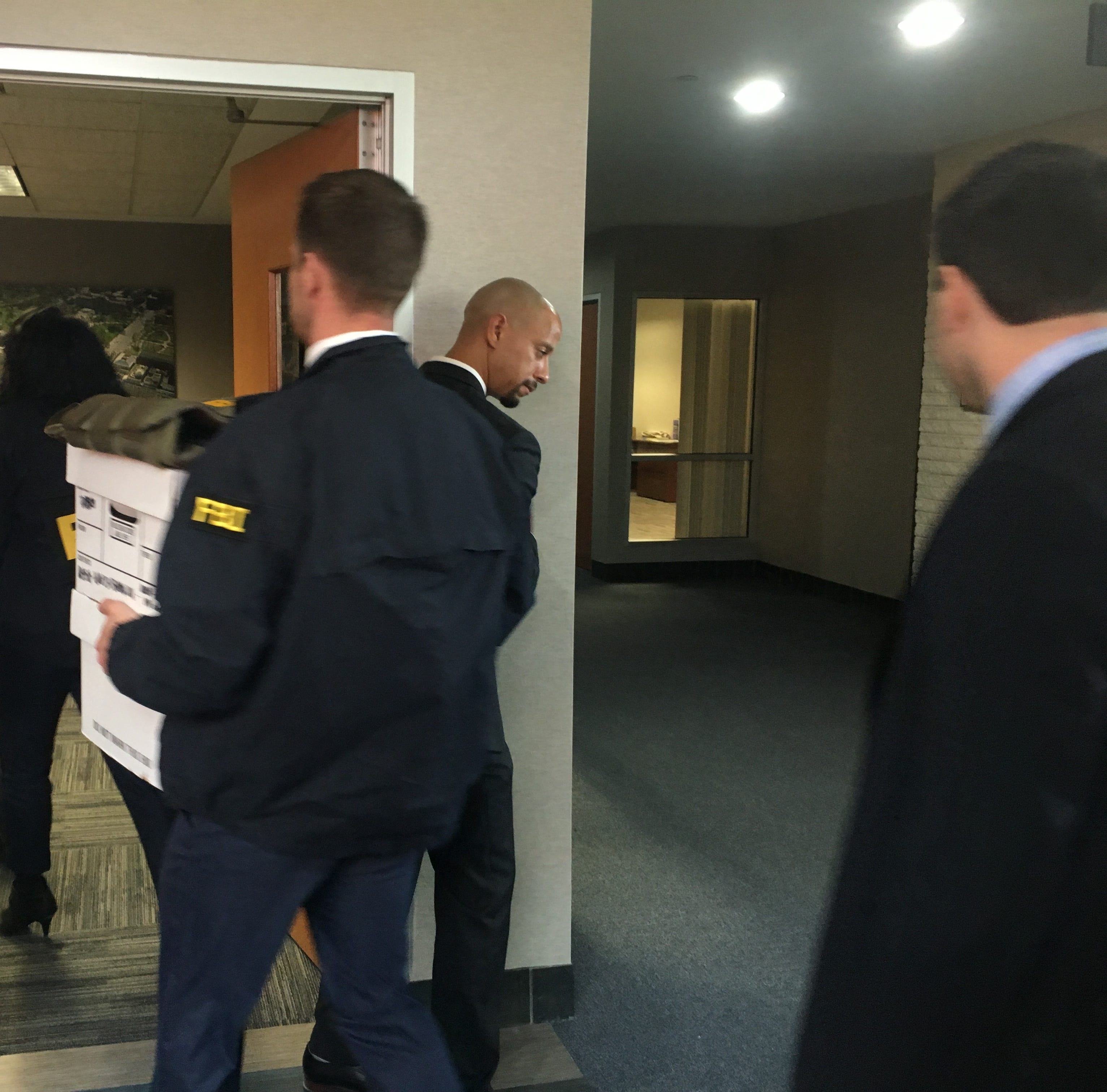 FBI agents carry boxes into Taylor Mayor Rick...