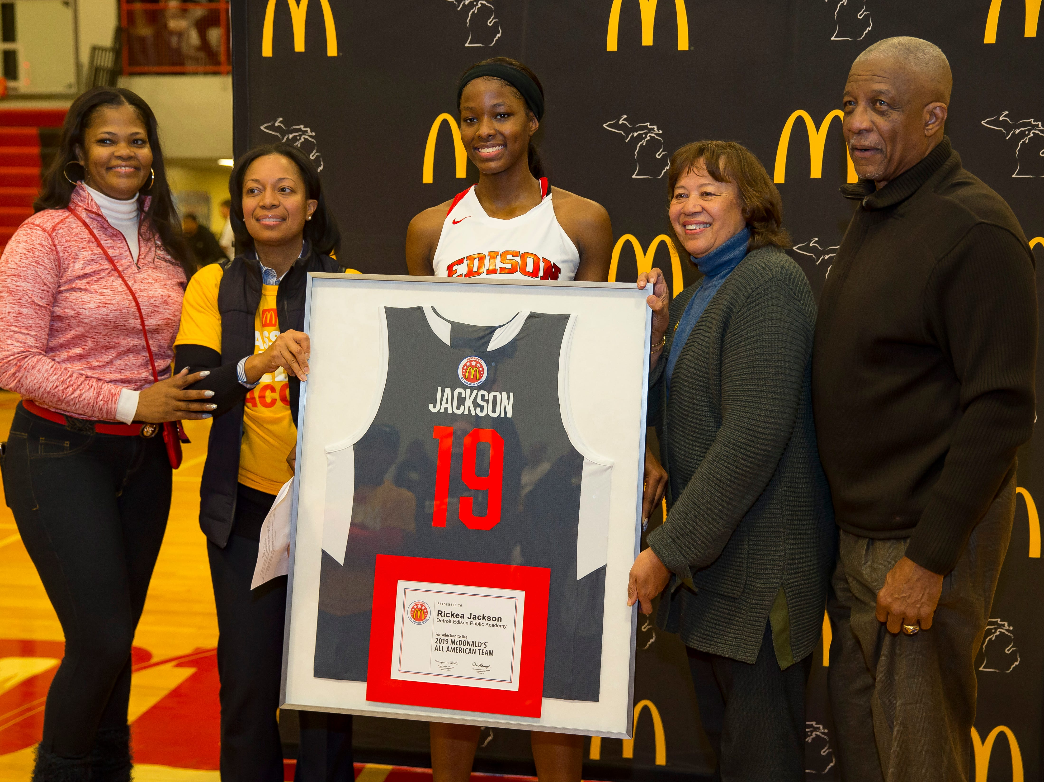 Rickea Jackson of Edison Academy is presented the 2019 McDonalds All American Team jersey at half time the game against Detroit Renaissance at Edison Academy High School. From L to R Rickea's Mom Caryn Jackson, Joni Thrower, McDonalds owner, Rickea Jackson, Marla Thrower, McDonalds owner, and James Thrower, McDonalds owner.  Edison Academy defeated Detroit Renaissance 67-26.