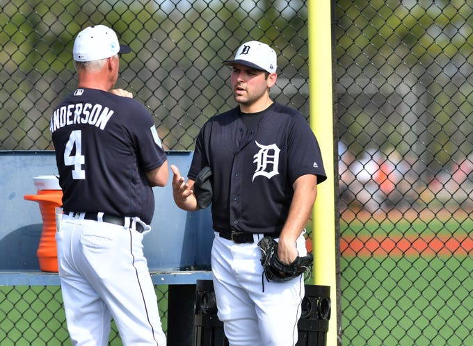 Tigers pitcher Michael Fulmer talks with pitching coach Rick Anderson (4) at the Tigers workout at the Tigers workout at spring training in Lakeland, Fla. on Feb. 19, 2019.