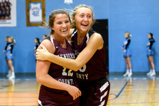 Henderson County's Emma Humphrey (12) and her teammate Alyssa Dickson (15) embrace as they celebrate their victory over the Union County Bravettes in the Girls 6th District Tournament at Union County High School in Morganfield, Ky., Monday, Feb. 18, 2019. The Lady Colonels defeated the Bravettes, 67-26.