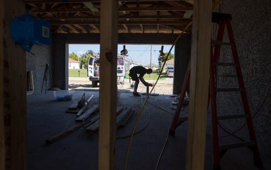 A construction worker installs eletrical lines to a new home being built in Cape Coral last year. Cape Coral has steadily increased the number of new construction permits it's approved in the past several years, as it works back up to pre-recession numbers.
