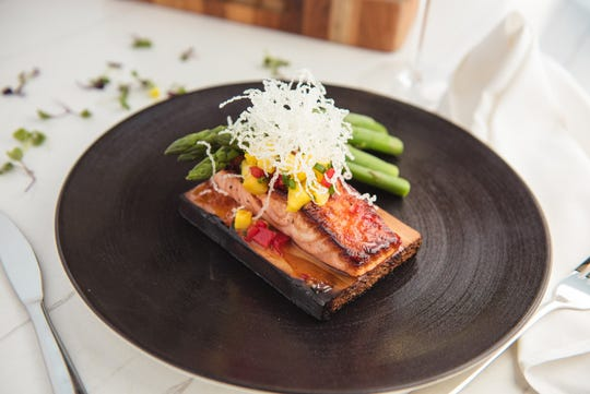 Cedar-plank salmon from Coste Island Cuisine At DiamondHead Beach Resort on Fort Myers Beach.