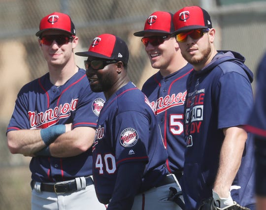 Riverdale High School graduate and current Minnesota Twins first base coach Tommy Watkins, center, watches members of the team go through drills on the first day of full squad workouts at Century Link Sports Complex Monday 2/18/2019. He has been in the Twins system for years and is coaching in the big leagues for the first time this year.